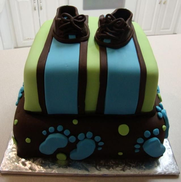 Baby shower cake for boy with brown slippers and footprints.JPG