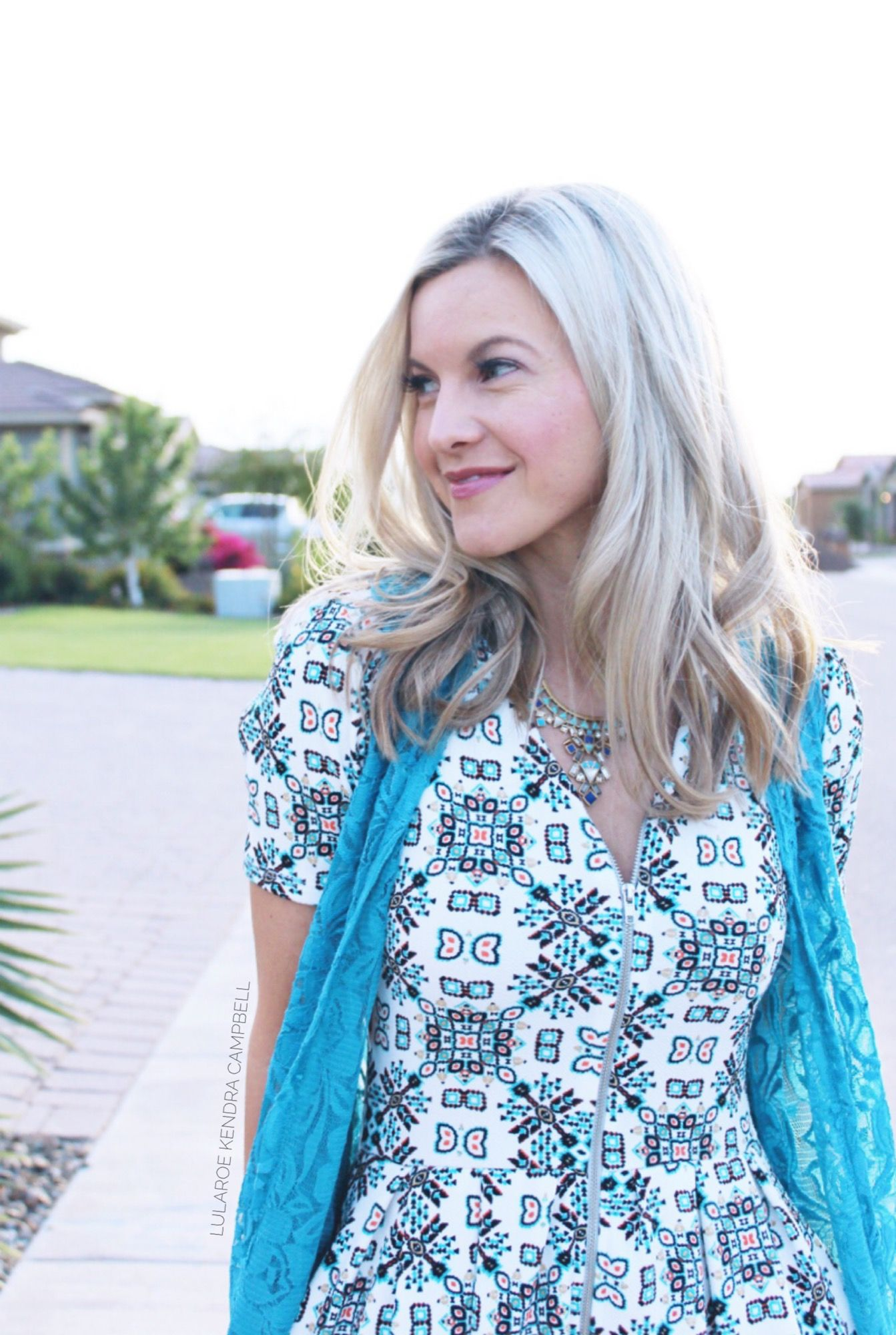 5f0c8ffeddd LuLaRoe   clothes that make you smile! This is the LuLaRoe Amelia dress  paired with a Joy vest. Click for more style inspiration and to shop LuLaRoe !