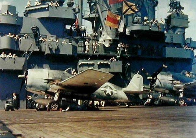 US Navy Lt. Cmdr. James H. Flatley's F6F-3 Hellcat fighter warming up on the deck of USS Yorktown, preparing to attack Marcus Island, 31 Aug 1943