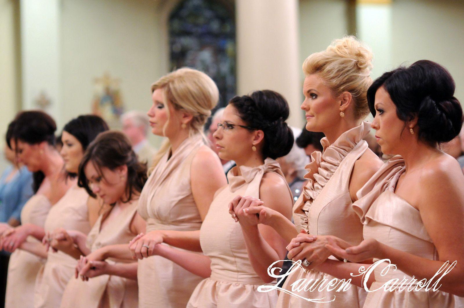 Bridesmaids praying in church laurencarrollphotography
