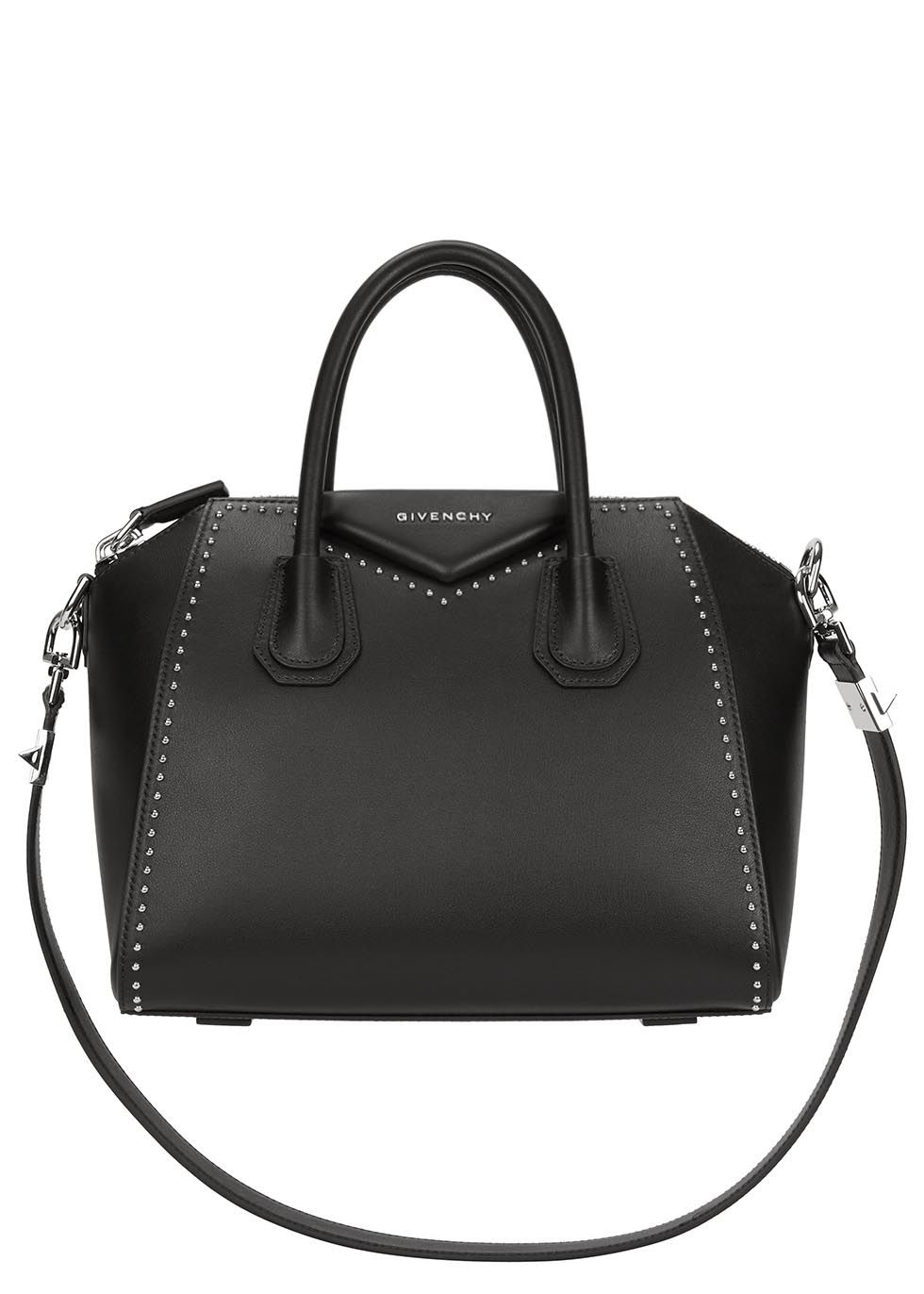 Givenchy black leather tote Two top handles, shoulder strap, studded, designer plaque, feet, silver hardware, internal zipped pocket, patch pocket, phone pocket, fully lined Zip fastening at top Comes with a dust bag