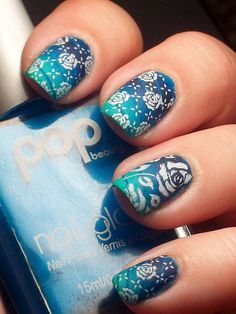 """By Vicky Kimberlin: """"Base of Pop Beauty Pacific Hoot and then I put tape down and did a gradient with Cult Nails Riot, Party Time, and Time Traveler. I stamped with Cult Nails Tempest and Pueen 22. I finished off with Seche and then added matte tc."""""""