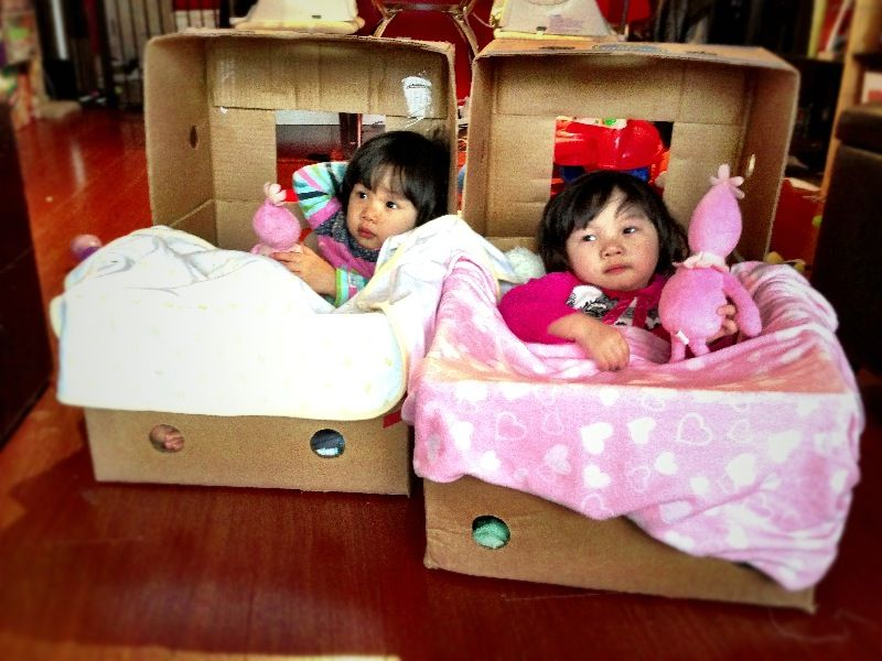 cardboard banana box made into mini beds lazy boy chairs or cars for the girls on a rainy day h lazy boy chair floor protectors for chairs imaginative play mini beds lazy boy chairs