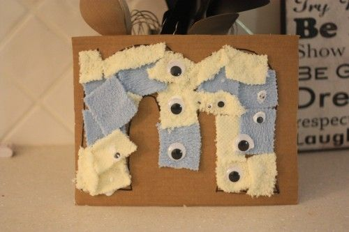 I want to do this with G with all letters-glue, pom poms, scrap paper, anything else I can think of--to help her start recognizing letters