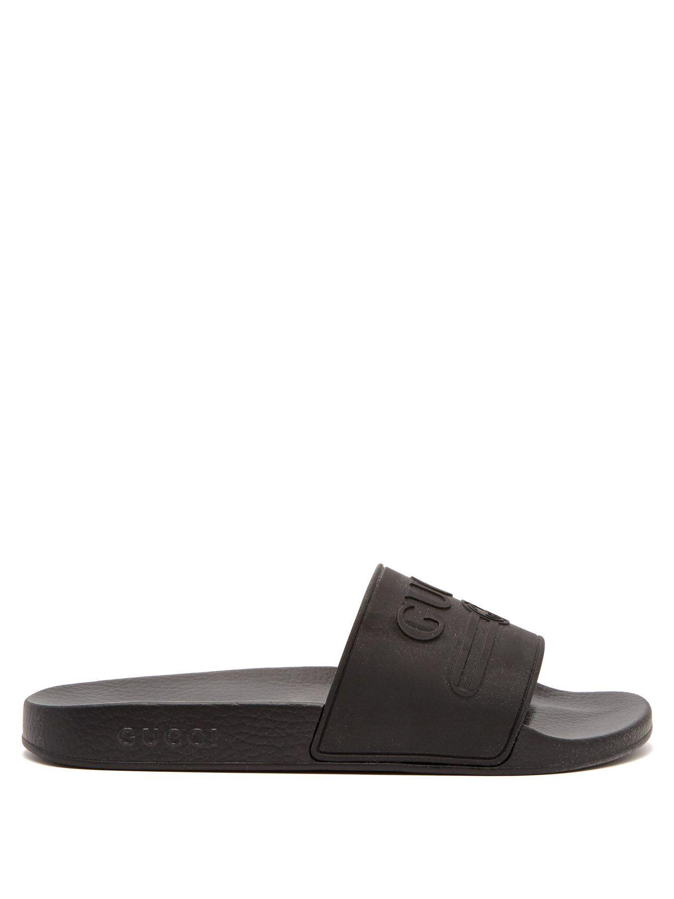 90ef3b5cb650 GUCCI GUCCI - LOGO EMBOSSED RUBBER SLIDES - MENS - BLACK.  gucci  shoes