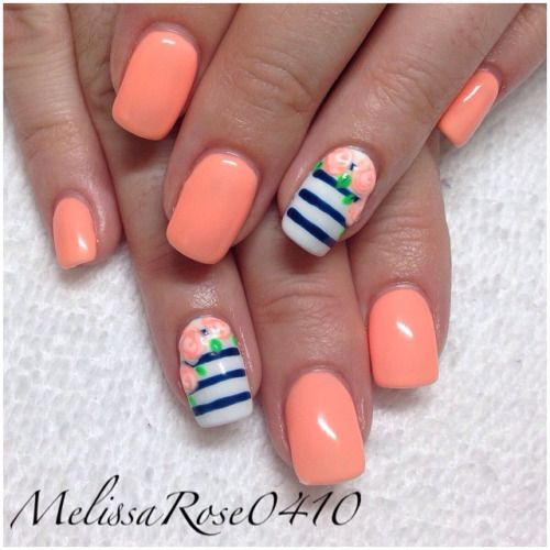 navy nails with orange accent nail