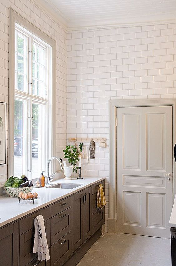 floor to ceiling subway tile large windows bottom cabinets only oversize hex floor