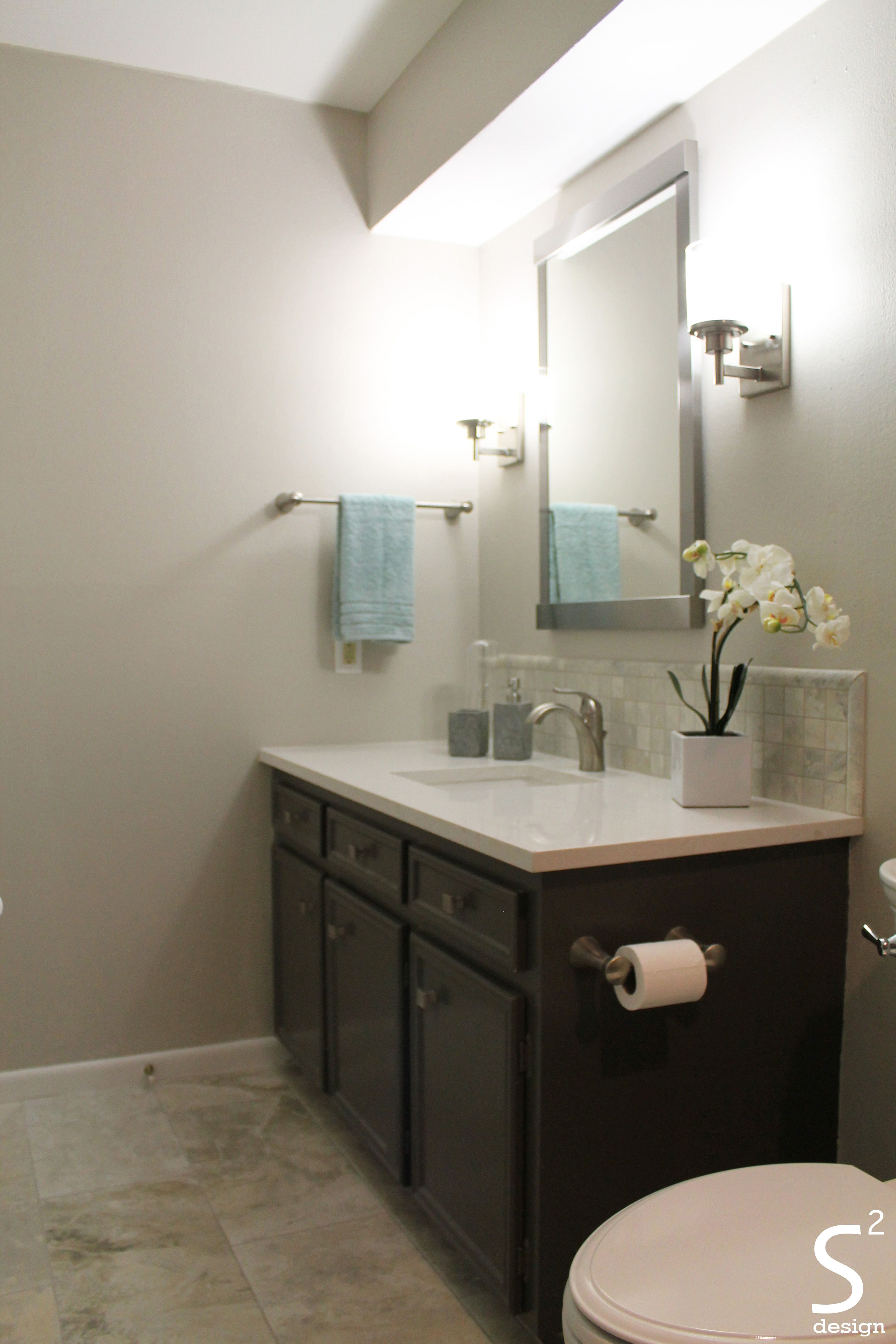 Modern Bathroom Grey Cabinet White Countertops Orchid Blue