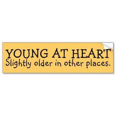 Young at heart slightly older in other places bumper sticker