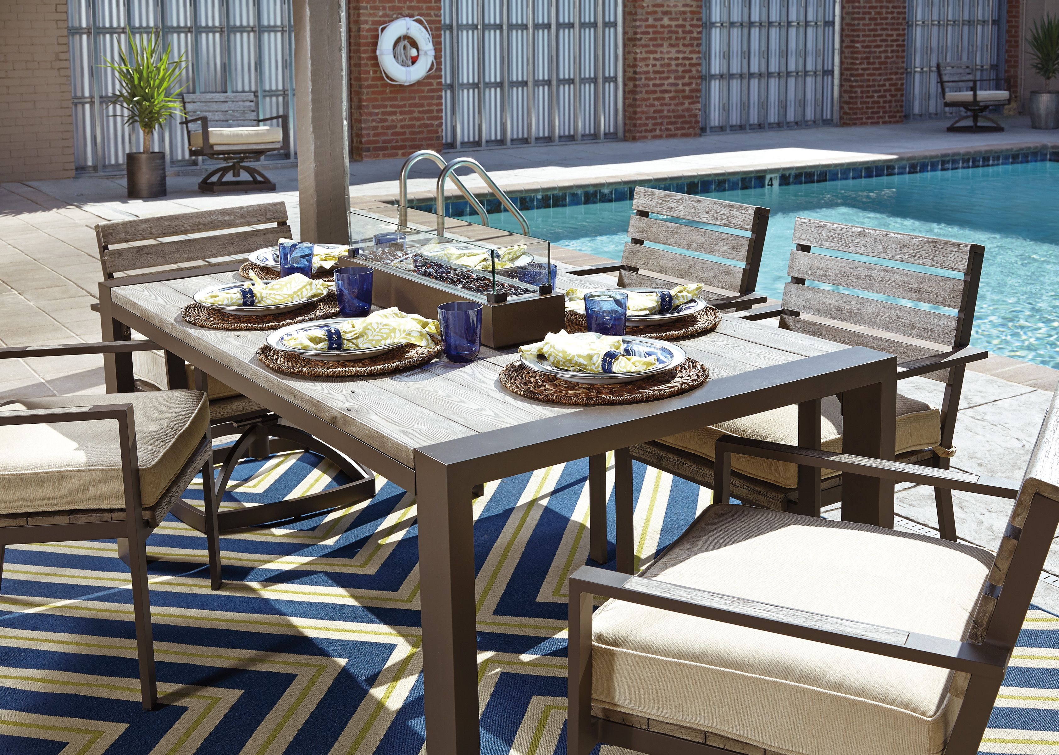 The Ashley Peachstone Has Us Dreaming About Days Relaxing By The Pool Patioideas Outdoor Dining Set Outdoor Furniture Sets Homemakers Furniture