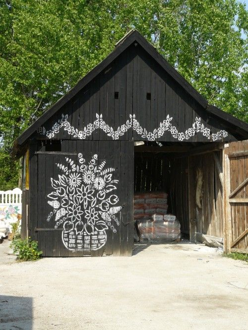 shed with art on the door