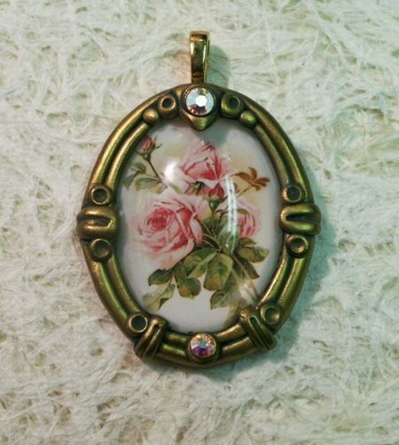Glass cabochon with rose picture set in vintage style gold polymer