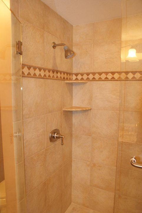 Black Tile Shower With Trim Google Search Amazing Bathrooms Shower Tile Shower Shelves