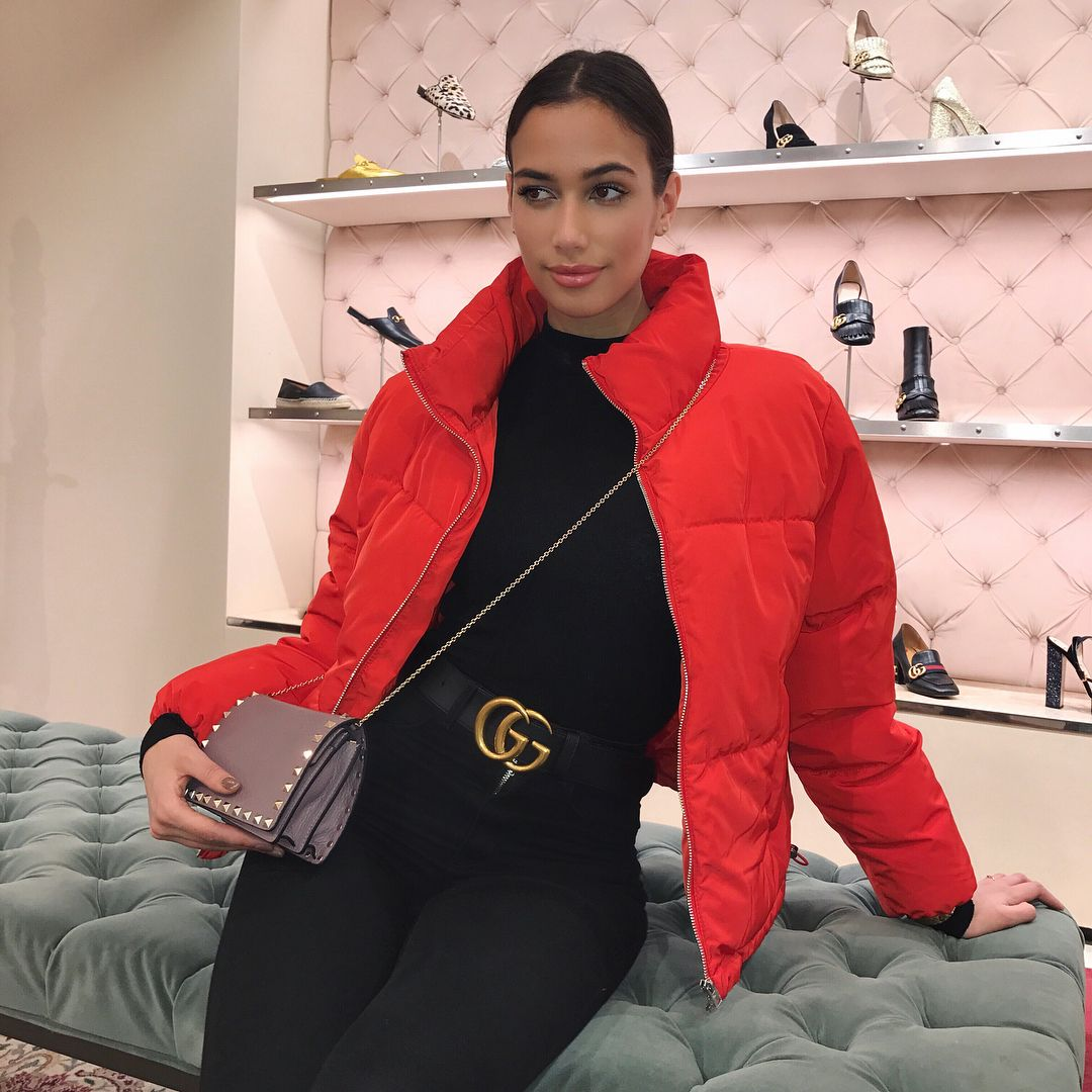 Black turtle neck sweater + black jeans + Gucci belt + bright red bomber  jacket. Trendy outfit idea.