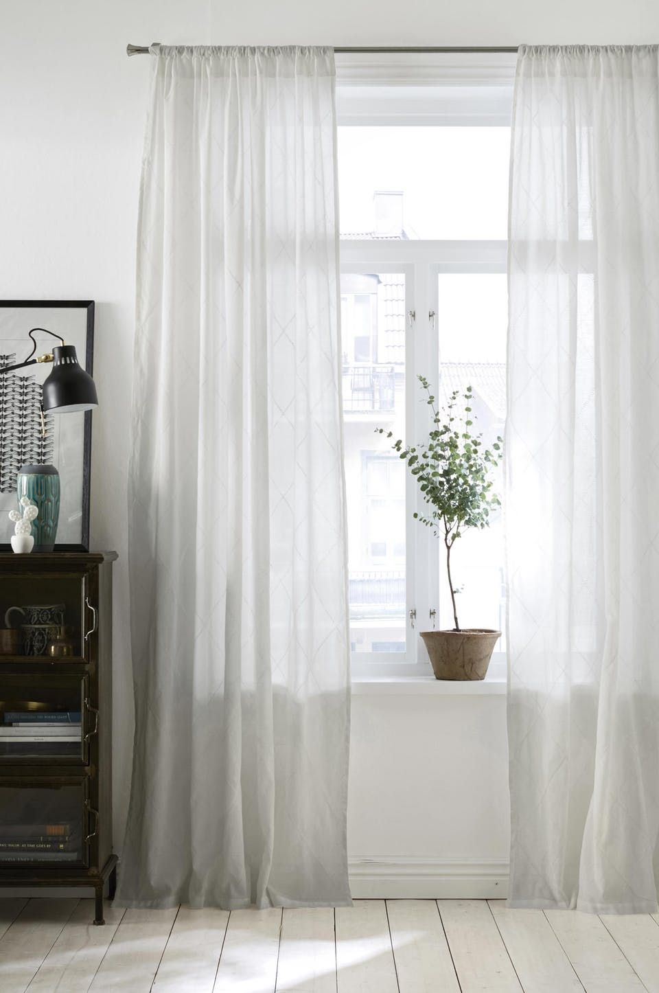 Give Your Rooms A Bright Airy Feeling With Thin White Curtains That Goes All The Way To Floor