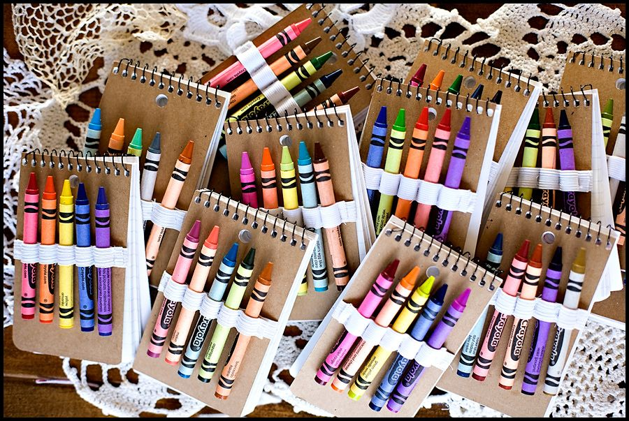 notebooks and crayons...see link for how to. awesome idea for missionary trip...also for party favors