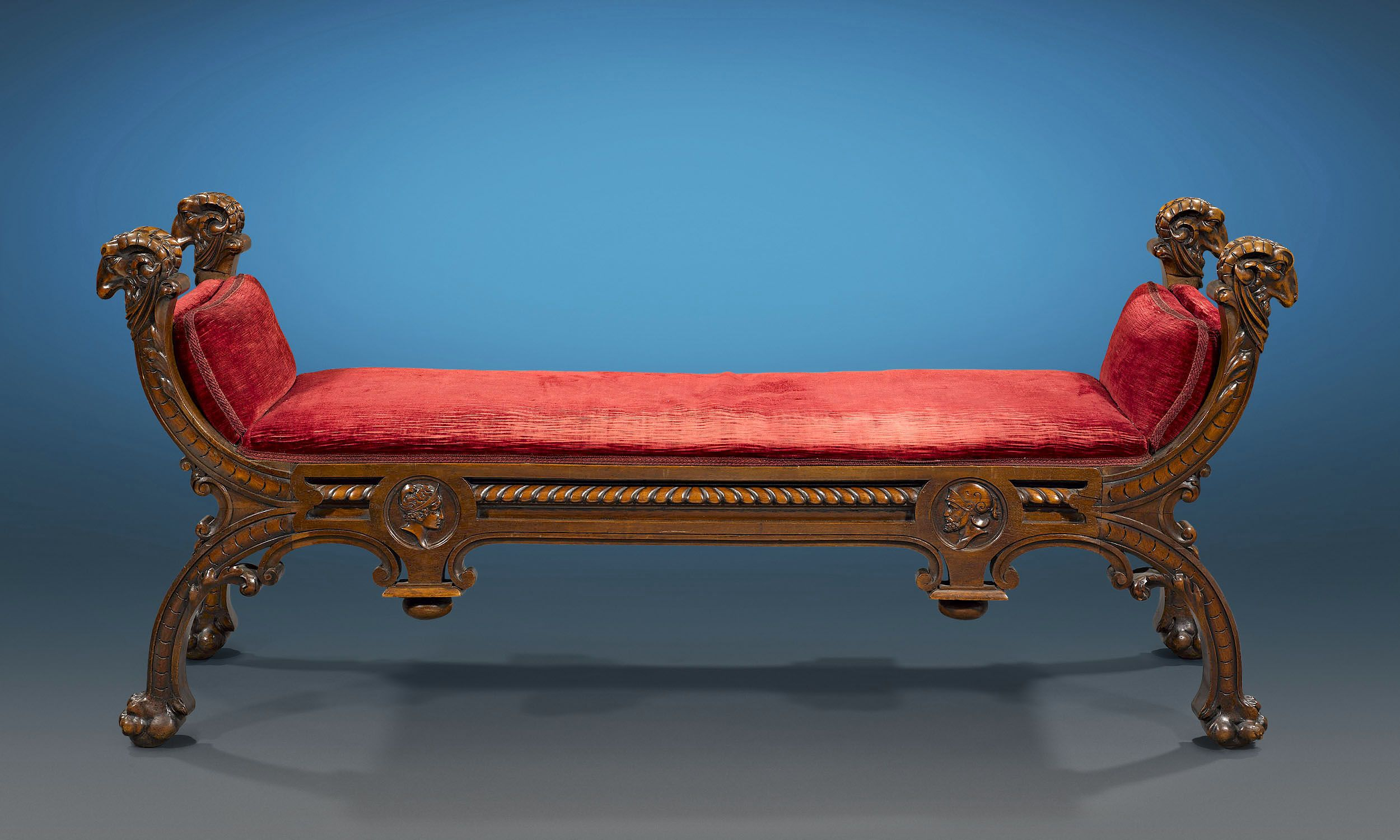 Italian Renaissance Revival Walnut Bench Sumptuous 16th-century style carvings typify this wonderful Italian Renaissance Revival walnut bench. Each corner is surmounted by intricate ram heads, while four lion paw feet support this luxurious seat. Classical, balanced and refined, this bench is a fine example of 19th-century Italian furniture design. Circa 1870