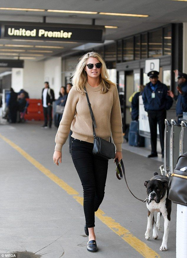 91ddf5ad02a It s a dog s life  Kate Upton still looks glamorous in a sweater and jeans  as she took her.