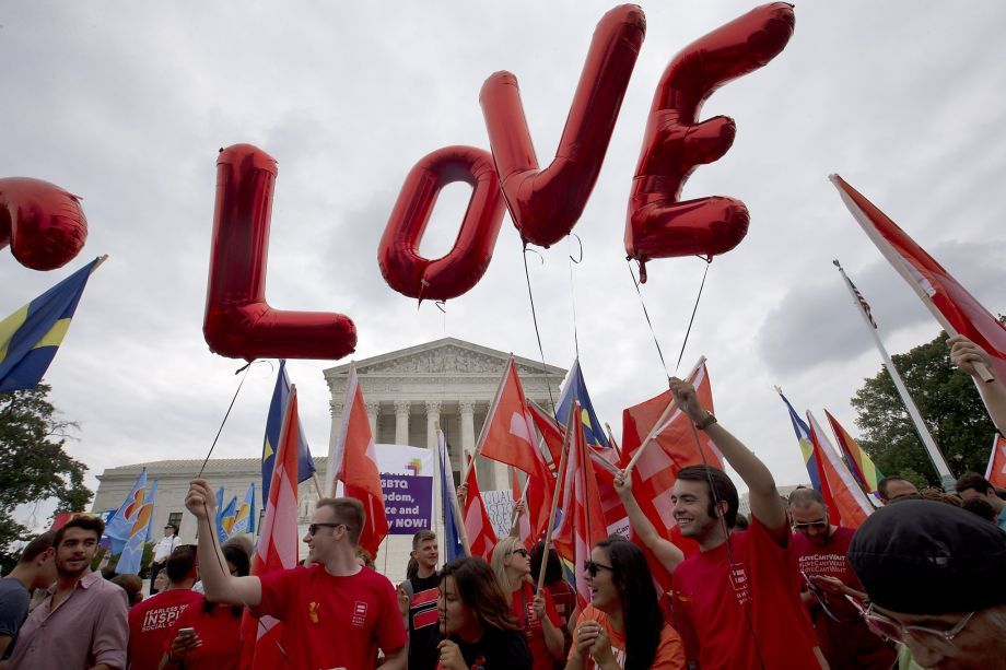 """Balloons spell out the word """"love"""" over the Supreme Court in Washington, Friday June 26, 2015, after the court declared that same-sex couples have a right to marry anywhere in the US.  Photo: Jacquelyn Martin, Associated Press"""