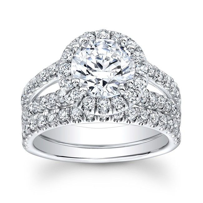 This Bridal Set Has A Split Shank On The Main Ring And A Simple Straight Band On Round Diamond Engagement Rings Halo Diamond Engagement Ring Set Round Diamonds
