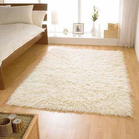 Small Flokati Rugs Next To Each Side Of The Bed Are Soft And Cozy On Bare