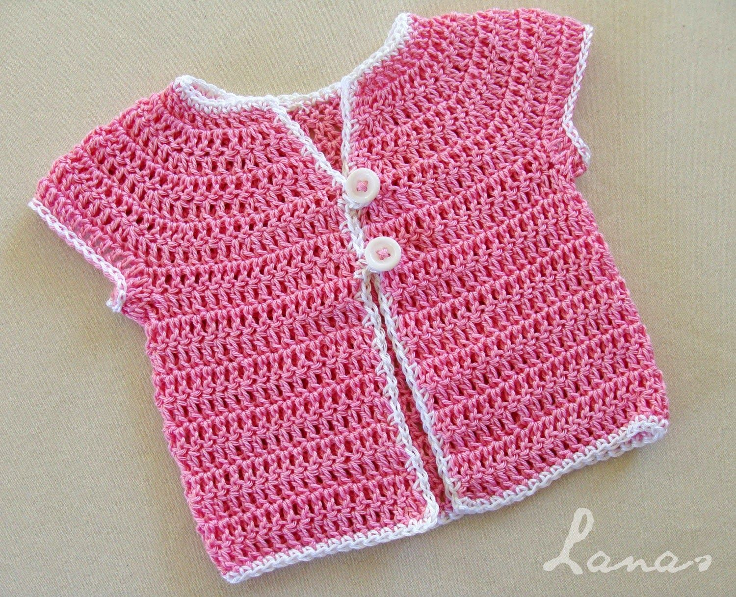 A crochet baby top with short sleeves, made from the top down. Use ...