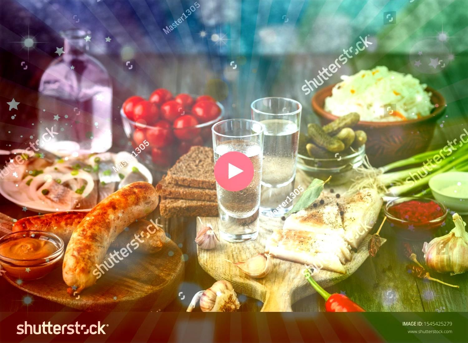with lard salted fish and vegetables sausages on wooden background Alcohol pure craft drink and traditional snack tomatos cabbage cucumbers Negative space Celebrating foo...