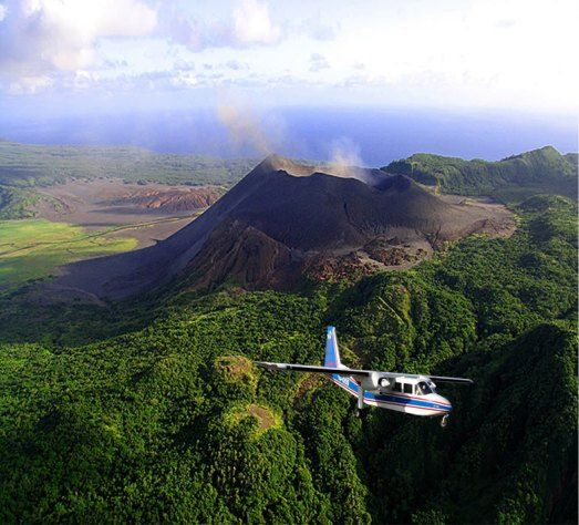 Perch on the edge of Mount Yasur Volcano on Tanna Island, Vanuatu. Can you see me? I'm in the cockpit!!!?