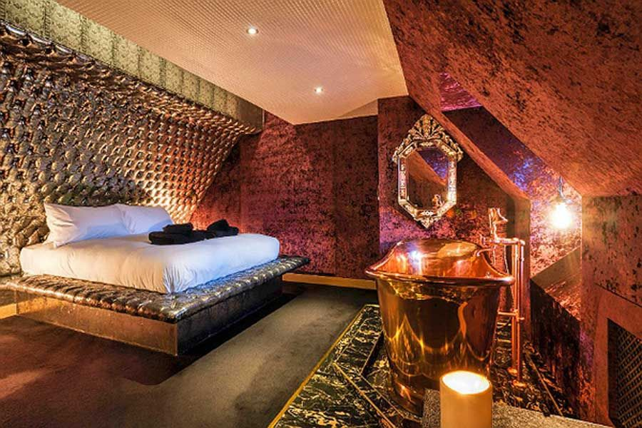 This Amazing Suite At The Crazy Bear Hotel Features A Stunning Copper Bath Mounted On Porcel