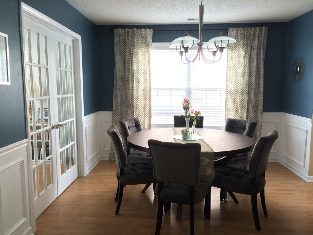 Navy and white dining room with round table  Sherwin