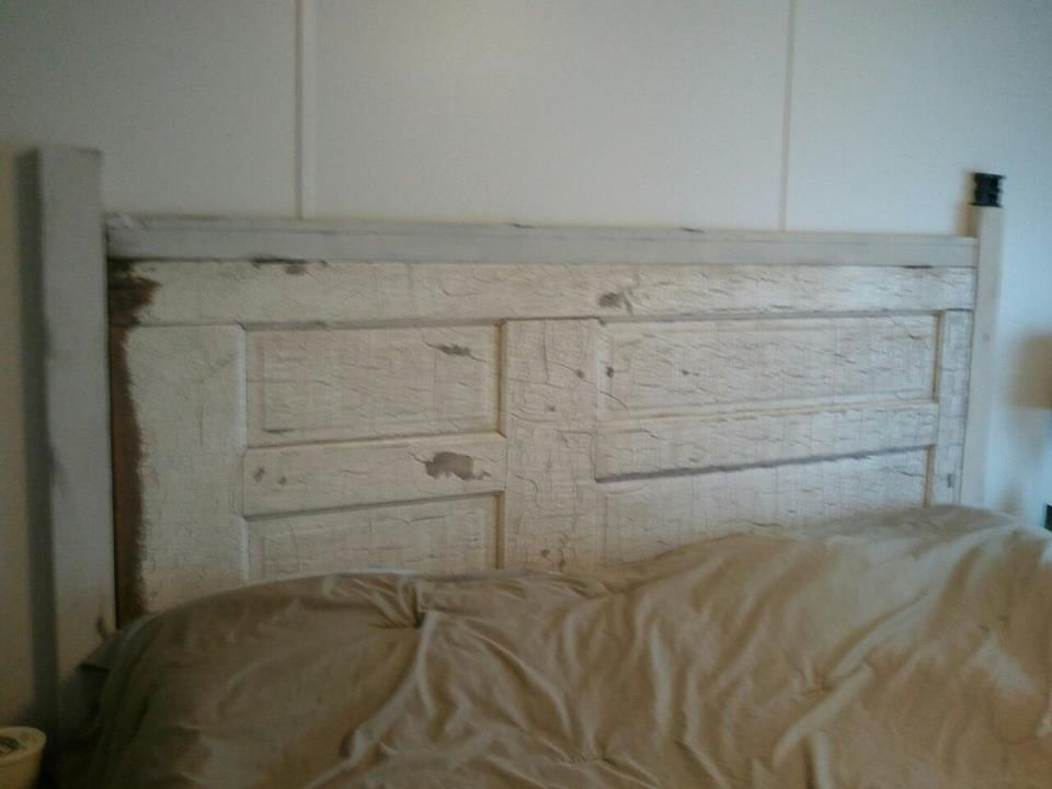 Our headboard. Homemade. We used an old door we scavenged from a farm. I sanded and used wipe on poly. Then my husband cut up some wood, I painted and stained that for an older look. My favorite piece in the house!
