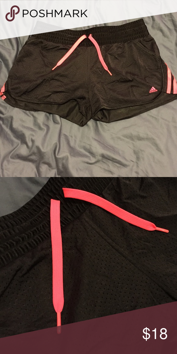 Black Adidas Running Shorts Black and neon pink Adidas running shorts. Stretchy mesh-like material, size large. Very comfortable, perfect for wearing to the gym or while lounging around the house. adidas Shorts