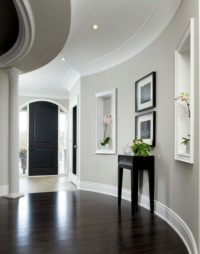 Brown Floor Grey Wall White Trim And Black Door