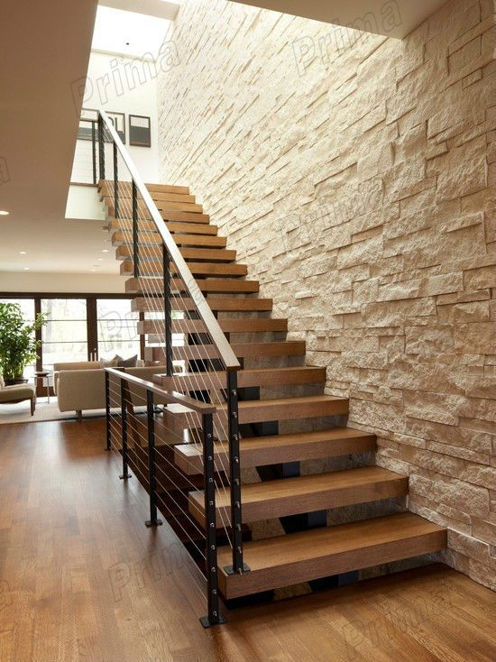 House design wrought iron cable railing modern wood stairs for Modern wood stairs