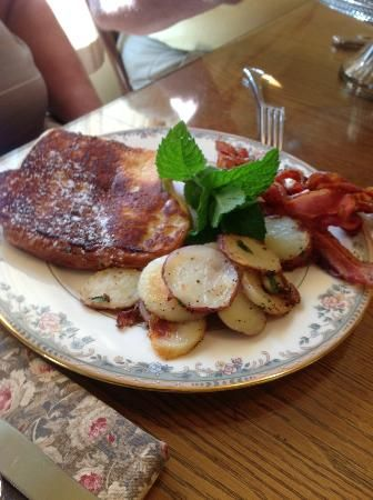Miller Haus Bed and Breakfast: Cream cheese & peach stuffed French toast with home fries and endless bacon; just a small part of breakfast.