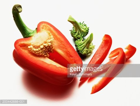 Stock Photo : Sliced red pepper and broccoli, close-up