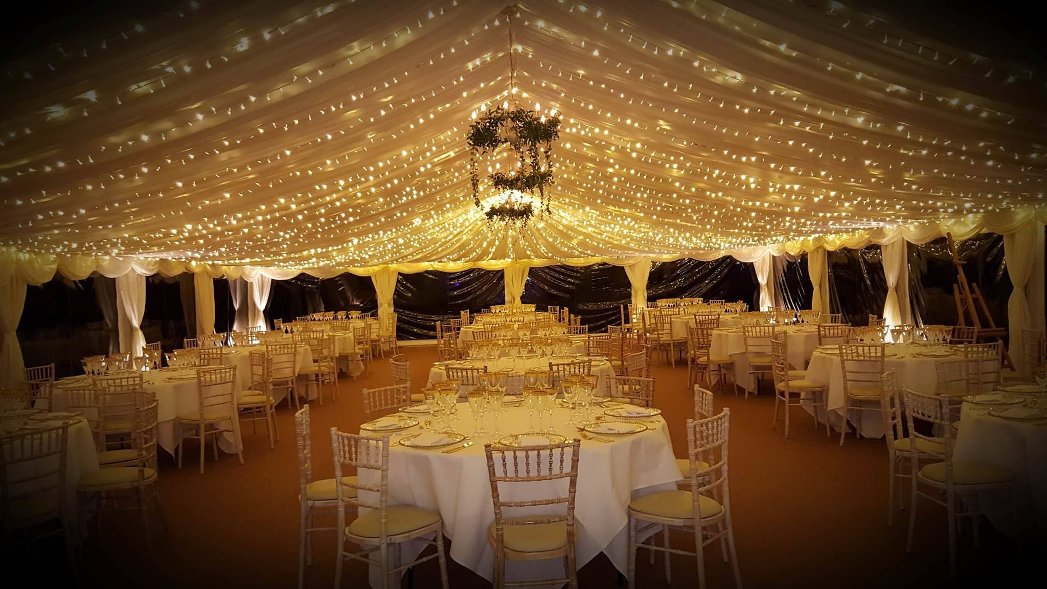 Our very own lakeside marquee with fairy light ceiling provided by Visually Sound