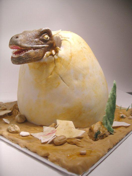 Totally awesome Dinosaur velociraptor Hatchling Cake We love