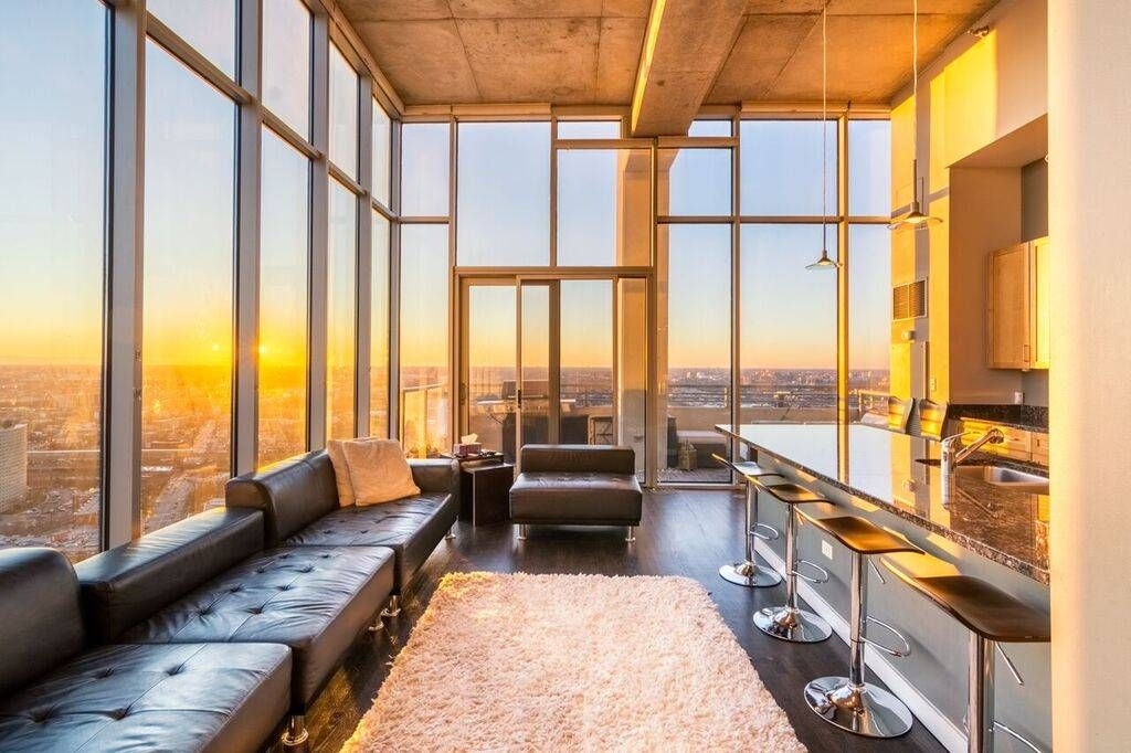 A Modern Chicago Apartment With Floor To Ceiling Windows Open Floor Plan Dark Hardwood Floors And Lots O Dream House Exterior Luxury Apartments Luxury Homes