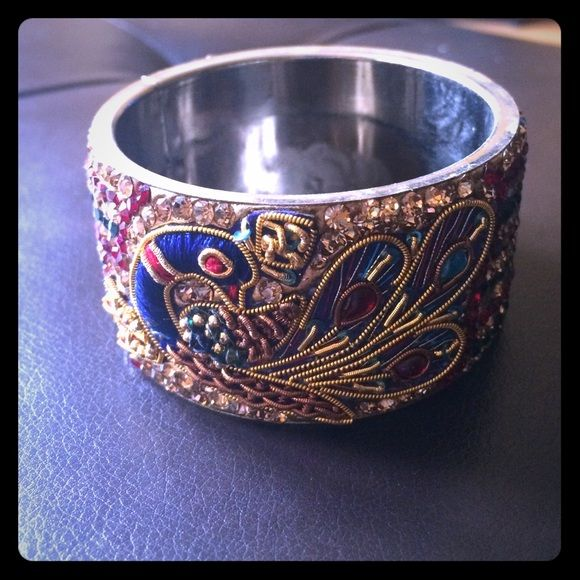 FLASH SALE!!! NEW Peacock chunky bangle bracelet The amount of detail on this piece is crazy! Thread work, beading and gemstones, it has it all. Super unique and great to dress up any outfit! Slip on only, no clasps. BRAND NEW never been worn Jewelry Bracelets