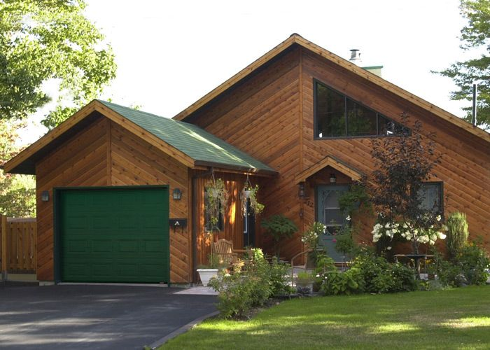 Choosing a green garage door to stand-out from the home's ... on Choosing Garage Door Paint Colors  id=47419