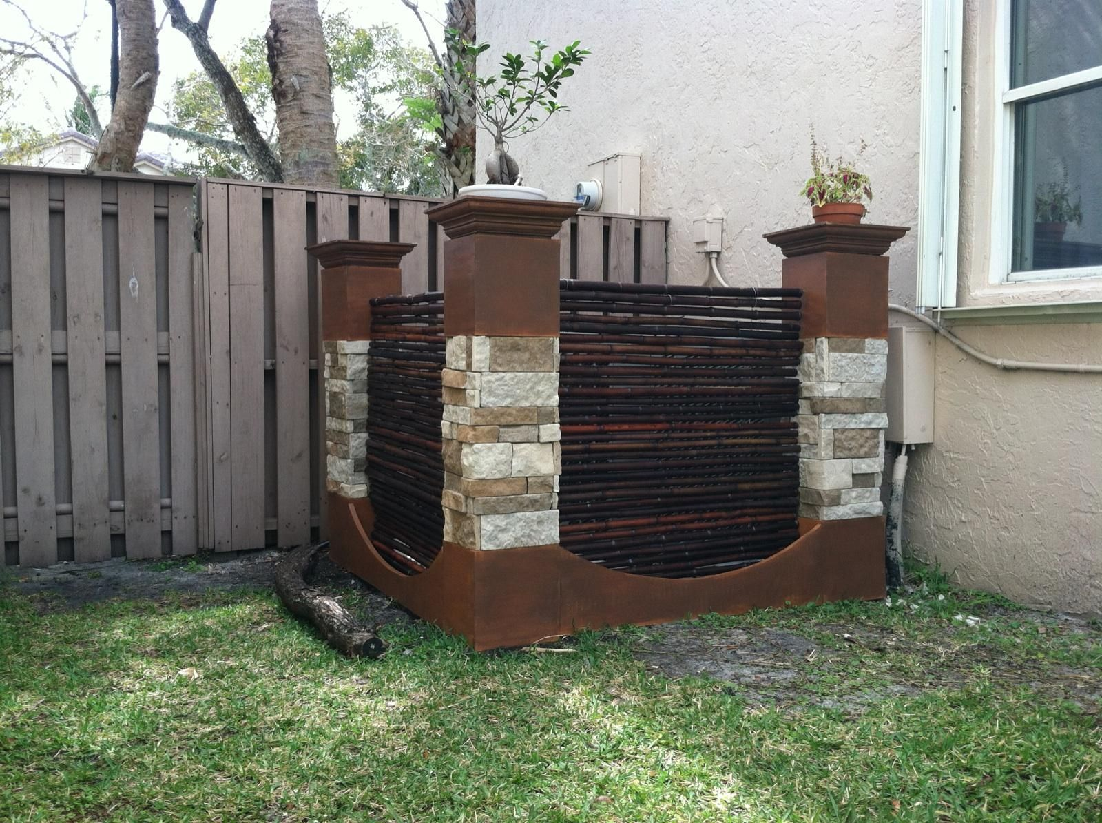 How to cover your air conditioner  Wooden pillars and bamboo