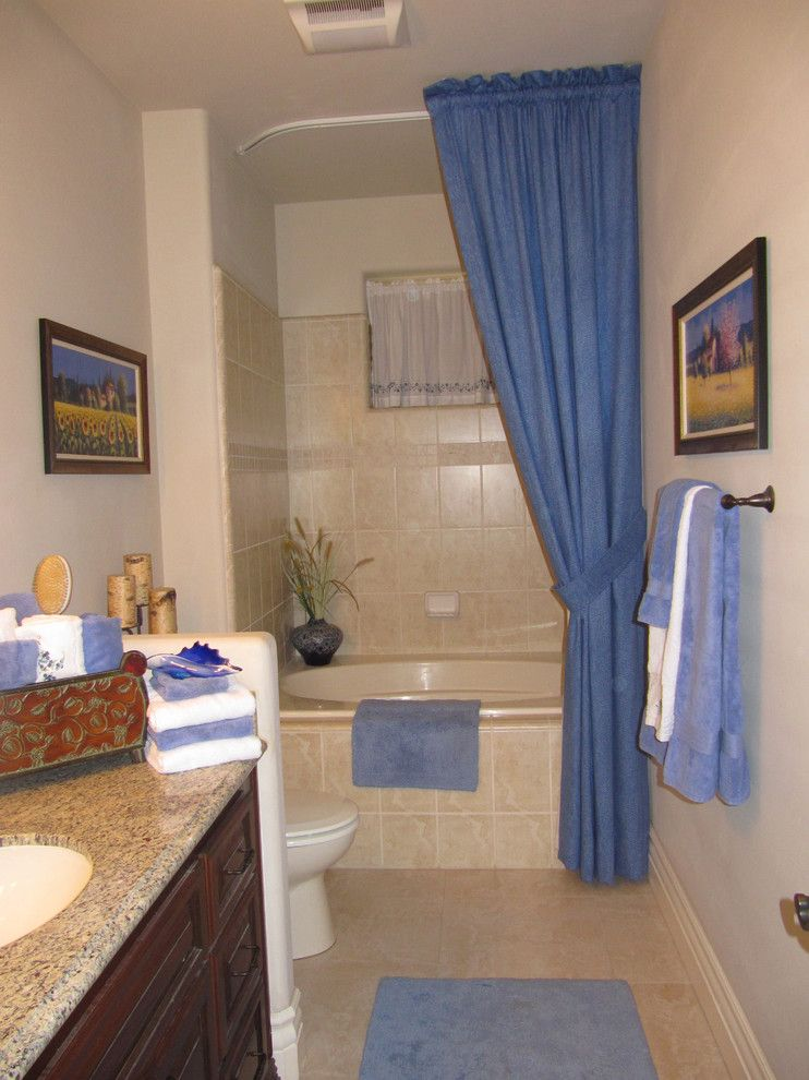ceiling hung shower curtain storage item towels blue paintings ...
