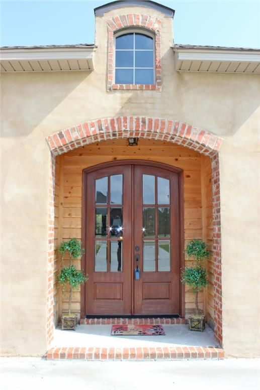 A one-story, three bedroom Acadian-style home makes a fashion statement with a classically simple but attractive front door with glass panes. http://www.theplancollection.com/house-plans/home-plan-26620 (Plan # 142-1090)