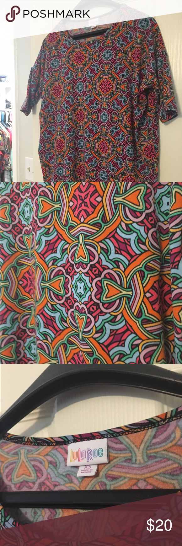 LuLaRoe XS Irma XS Irma excellent condition. Worn a few times and washed per LuLaRoe standard. Super cute! LuLaRoe Tops Tunics