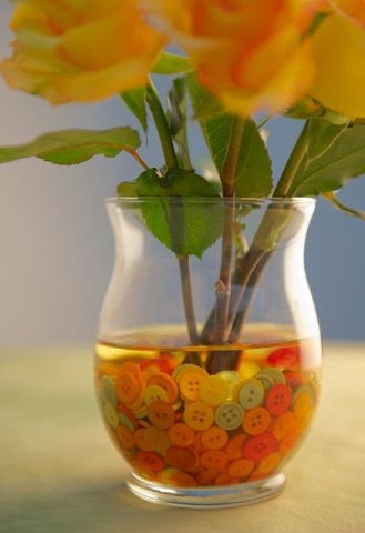 match colorful buttons to your cut flowers in the bottom of a vase