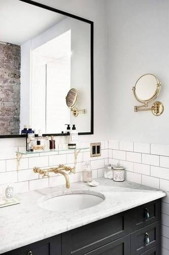 Gorgeous black, white and brass bathroom | Domino
