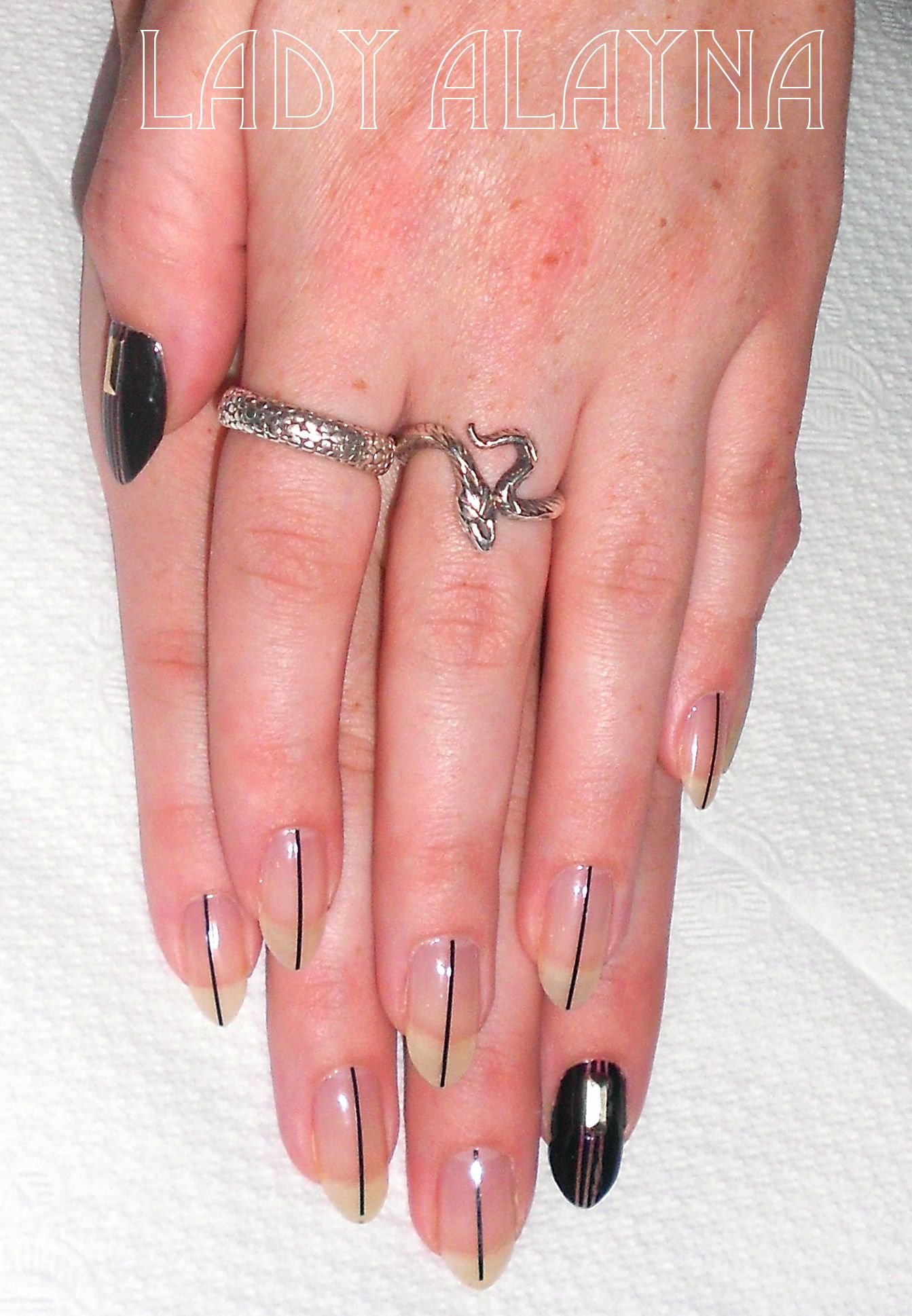 Linear nail art on natural nails with black striping tape, kind of a ...