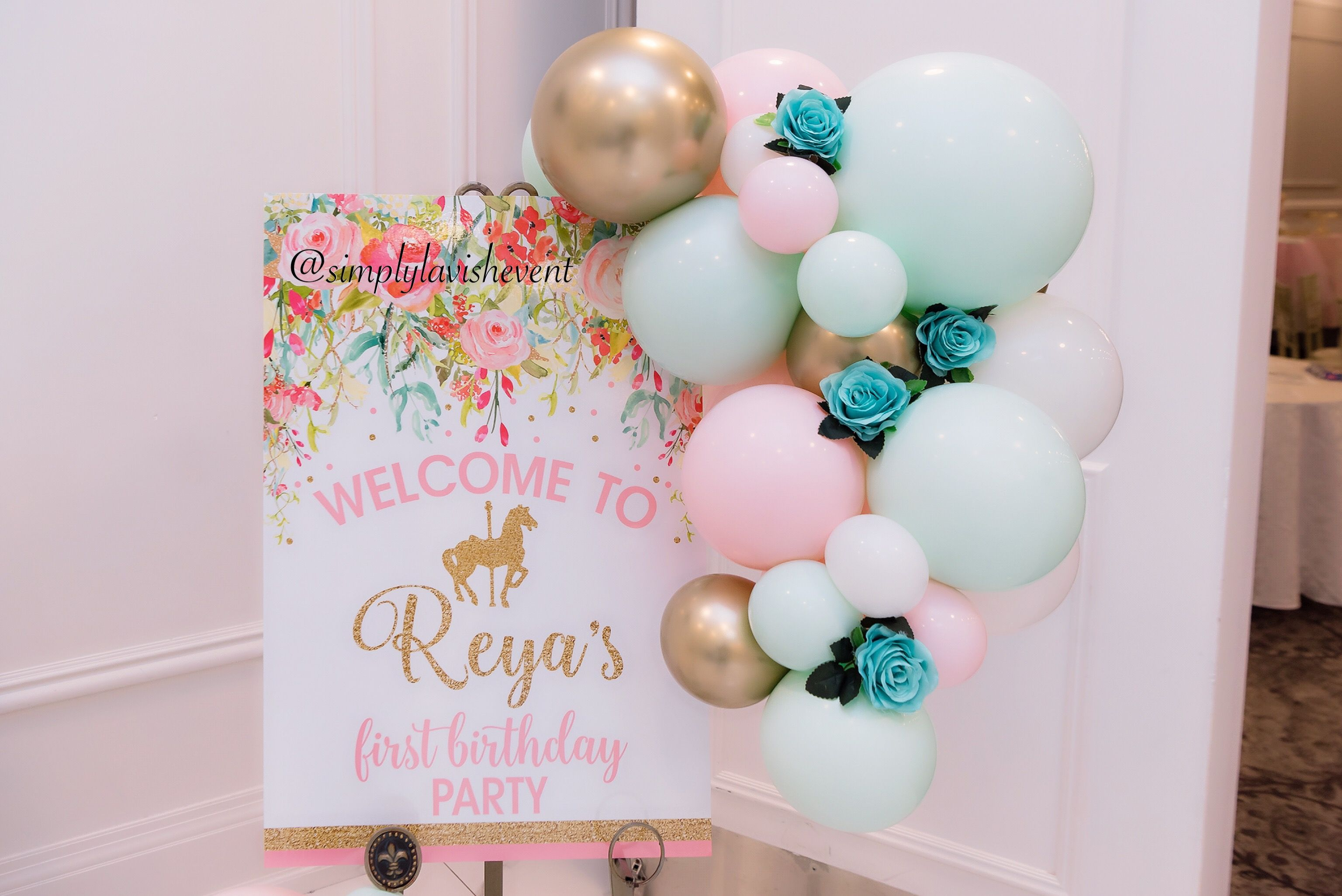 A Beautiful Cascading Balloon Garland Made This Welcome Sign Even