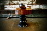 Modern organic biomorphic Stainless Steel bowl and live edged side table with hand-formed patinated steel base.